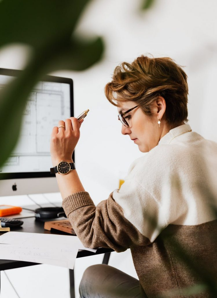 focused businesswoman reading documents
